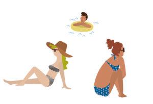 海辺で日光浴をしている人々
